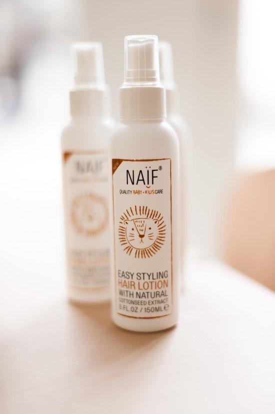 Naïf haarlotion 150ml witte fles bruin etiket met leeuw sfeer foto